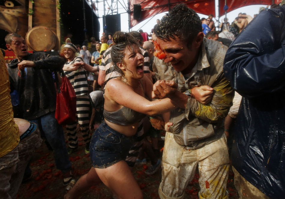 Revellers take part in a tomato fight