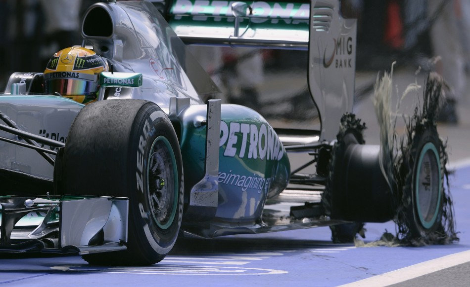 Mercedes'r Lewis Hamilton enters the pit after suffering a blow-out at the British Grand Prix at Silverstone (Reuters)