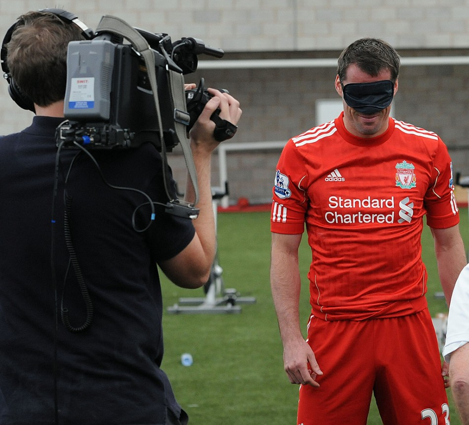 Liverpool Football Club players show support for Standard Chartered's Seeing is Believing charity (Photo: Standard Chartered)