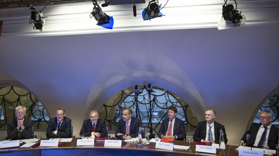 Mark Carney, the governor of the Bank of England (C), attends a monetary policy committee (MPC) briefing with (L-R) Martin Weale, a monetary policy committee member at the Bank of England, Spencer Dale, chief economist at the Bank of England, Charles Bean