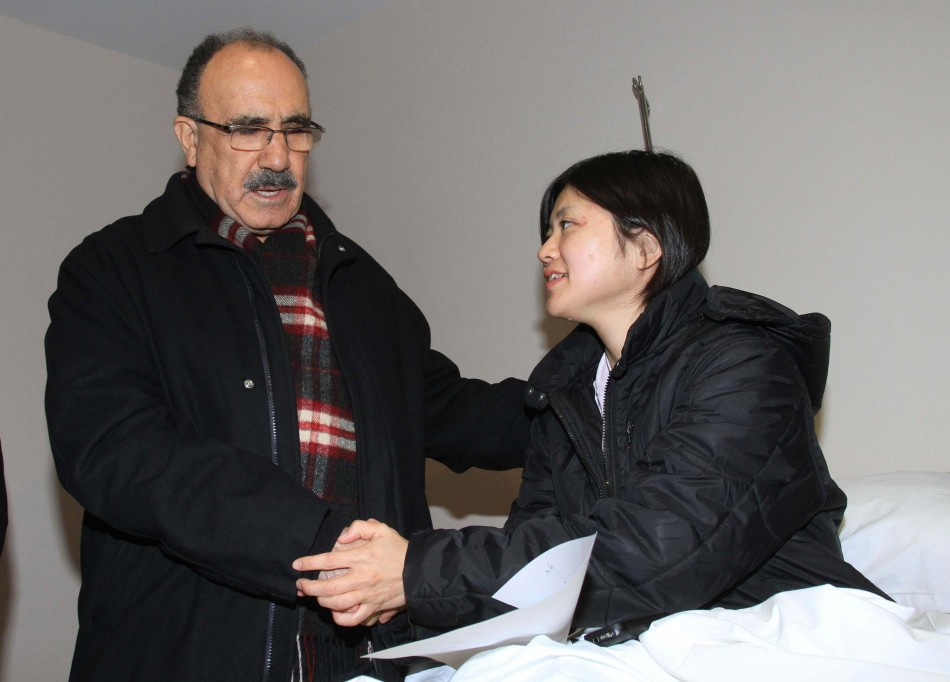 Turkey's Deputy Prime Minister Besir Atalay (L) visits Japanese earthquake survivor Miyuki Konna