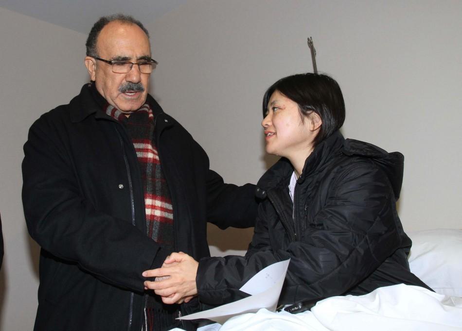 Turkey's Deputy Prime Minister Besir Atalay (L) visits Japanese earthquake survivor Miyuki Konna