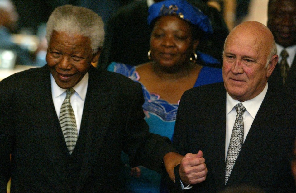 Former South African Presidents Nelson Mandela and FW de Klerk pictured celebrating 10 years of democratic rule (Reuters)