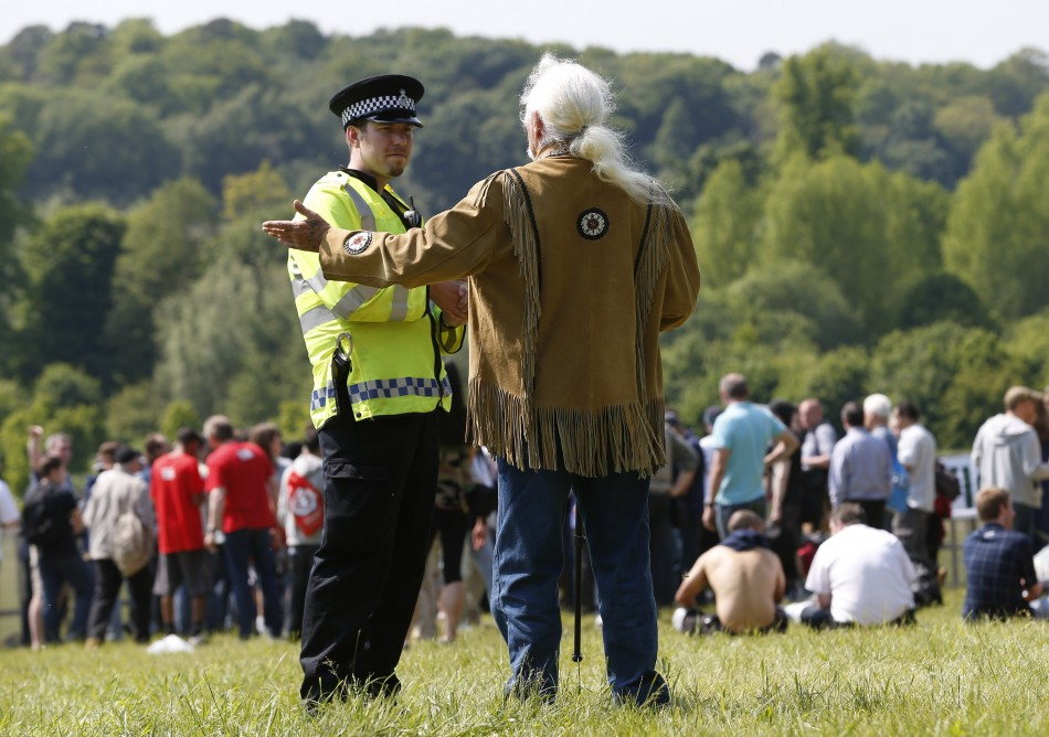 Policeman talks to protester in grounds of Grove Hotel