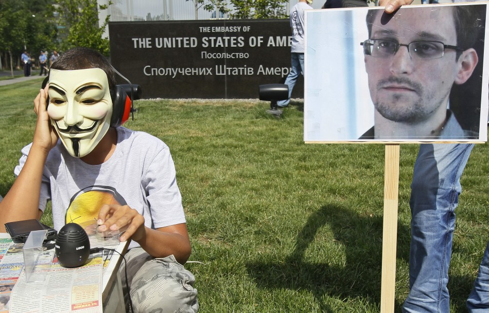 Activists from the Internet Party of Ukraine perform during a rally supporting Edward Snowden, a former contractor at the National Security Agency (NSA), in front of U.S. embassy, in Kiev June 27, 2013. (Photo: Reuters)