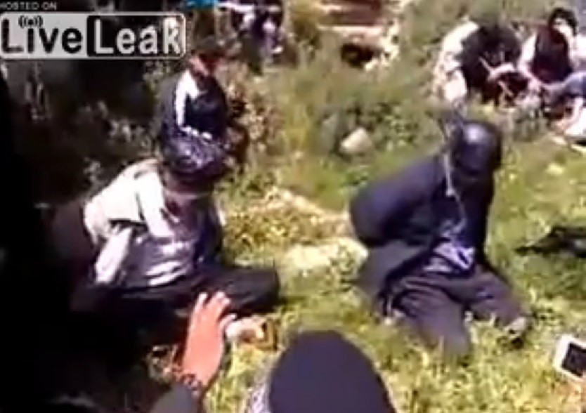 Picture of video showing beheading of two people (LiveLeak)