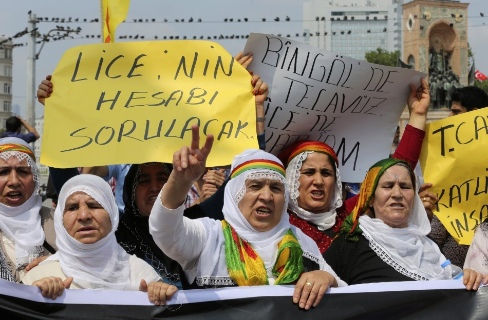 Kurdish protesters shout slogans during a demonstration against Turkish security forces