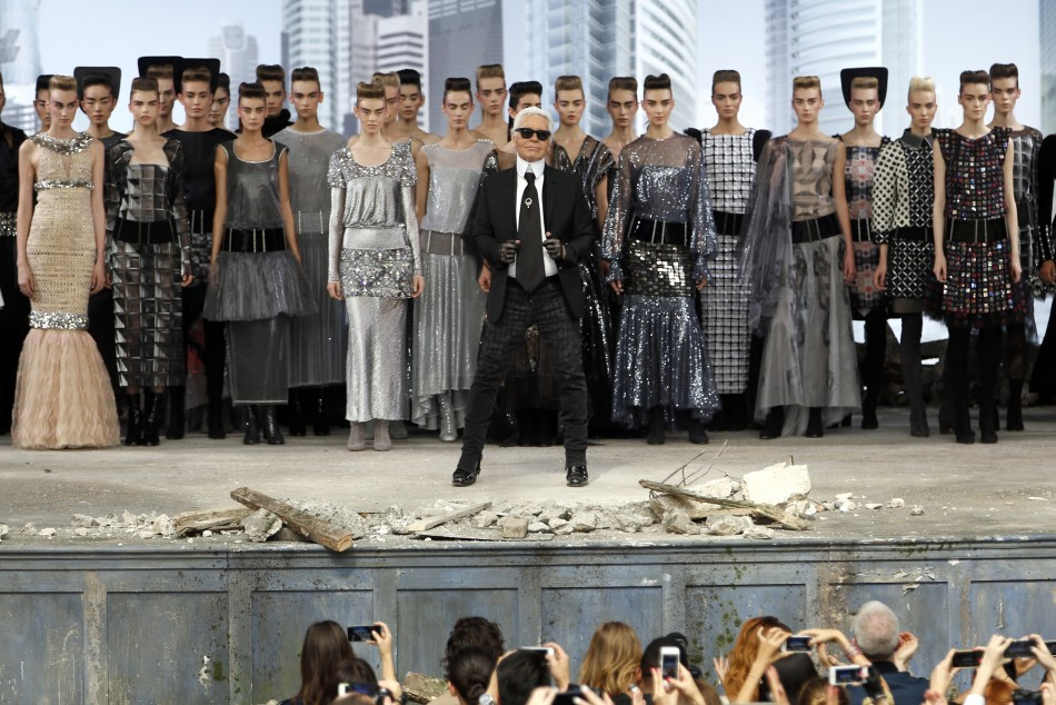 German designer Karl Lagerfeld front C appears with models at the end of his Haute Couture Fall Winter 20132014 fashion show for French fashion house Chanel in Paris July 2, 2013.