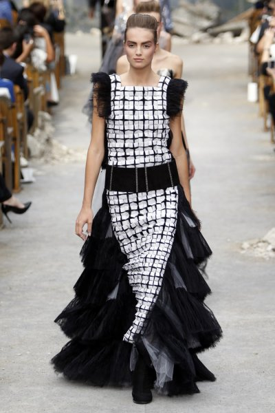 A model presents a creation by German designer Karl Lagerfeld