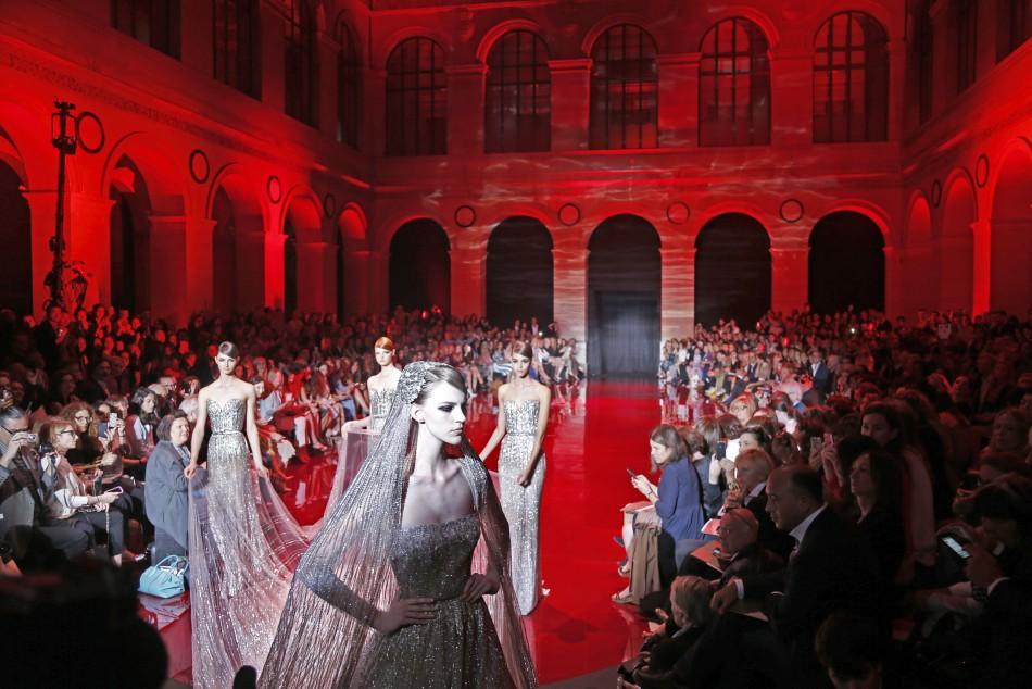 Models present creations by Lebanese designer Elie Saab as part of his Haute Couture Fall Winter 20132014 fashion show in Paris