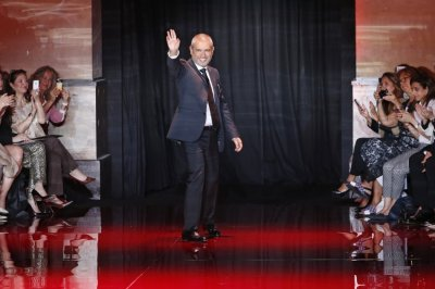 Lebanese designer Elie Saab appears at the end of his Haute Couture Fall Winter 20132014 fashion show