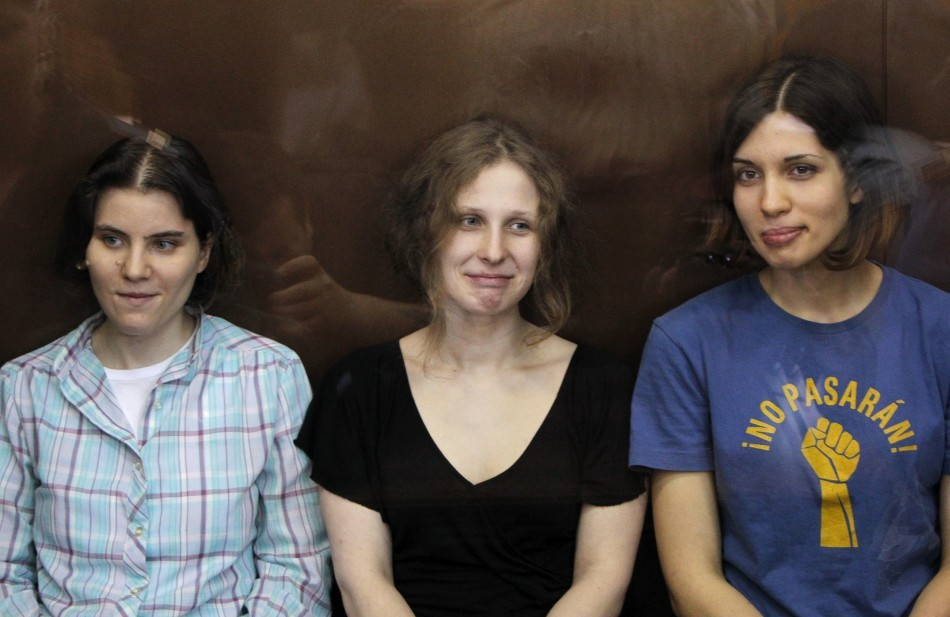 Pussy Riot members in glass-walled cage during a court hearing in Moscow (Reuters)