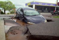 A car trapped in a sink Hole
