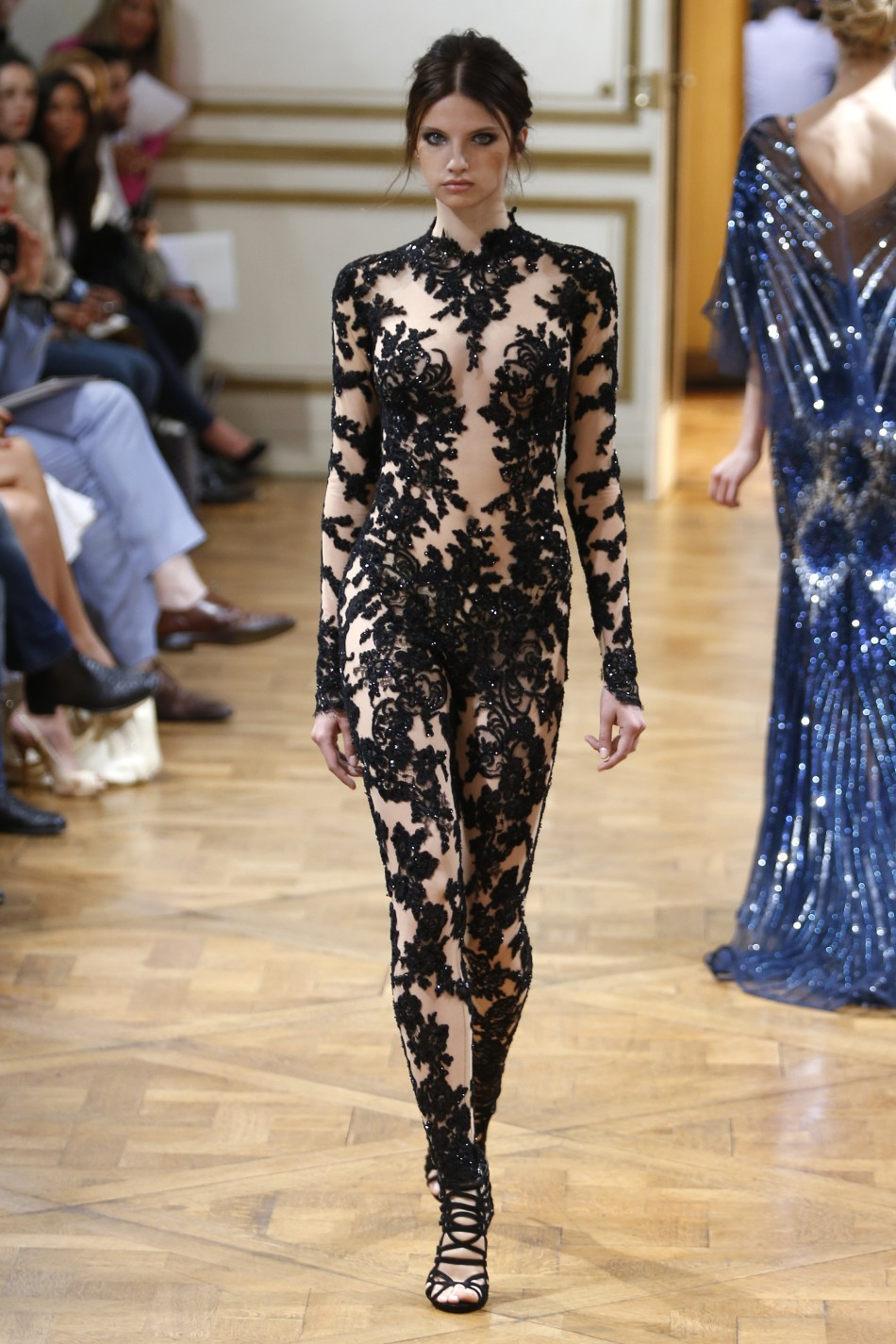 Model in a black lace-and-sequined Zuhair Murad Couture jumpsuit