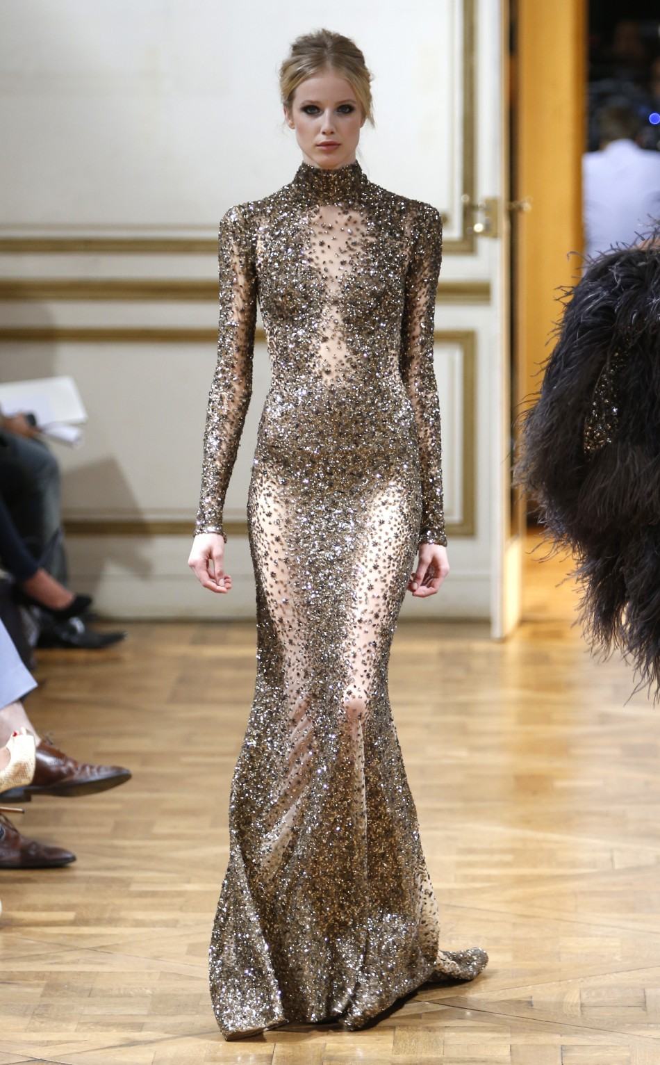 A body-fit silver gown with sequins, semi-precious stones and intricate embroidery
