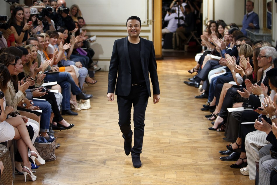 Lebanese designer Zuhair Murad appears at the end of his Haute Couture Fall Winter 20132014 fashion show in Paris July 4, 2013.