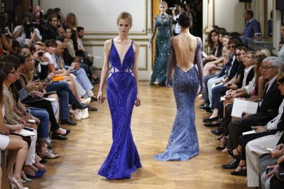 Murads stunning collection featured flowing lace gowns, see-though shift dresses and provocative thigh-high splits.