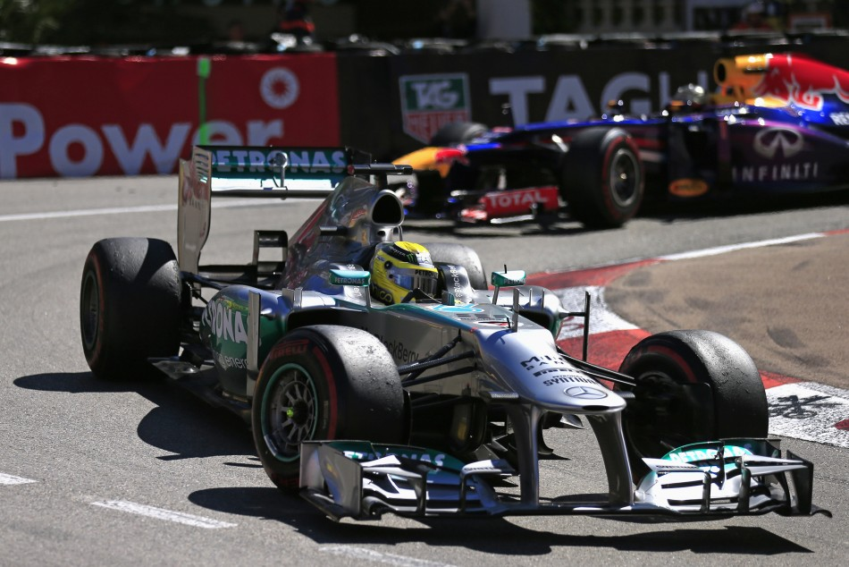 Nico Rosberg [Mercedes F1] (L) and Sebastian Vettel [Red Bull Racing-Renault]