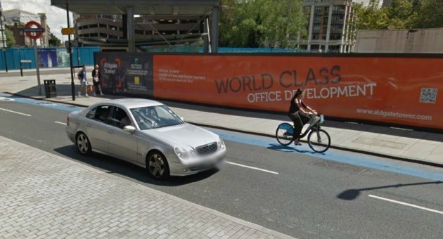 Blue cycle lane outside Aldgate Tube station, where teen died