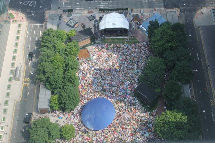 View from Canary Wharf tower of crowds in front of Wimbledon screens