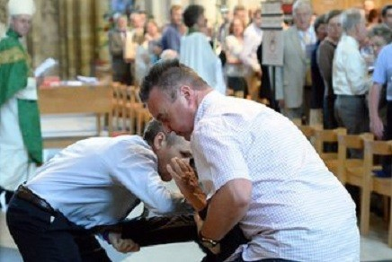 A man is arrested at a General Synod service at York Minster on 7 July
