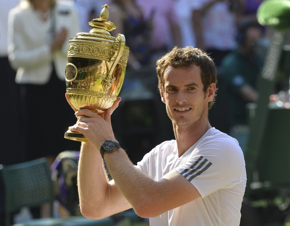 History in the making: Andy Murray clasps Wimbledon trophy