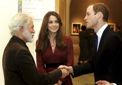 Glasgow-born artist Paul Emsley L greets Prince William R during a private viewing of his new official commissioned painting of Catherine, Duchess of Cambridge at the National Portrait Gallery in London January 11, 2013.