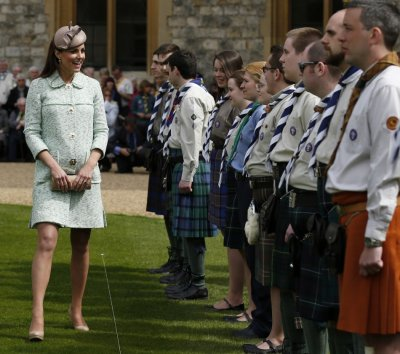 Catherine, Duchess of Cambridge meets scouts during at the National Review of Queens Scouts at Windsor Castle in Berkshire, near London April 21, 2013.