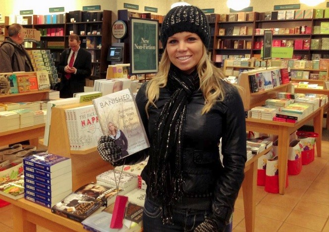 Drain with her book, 'Banished'