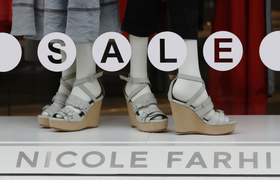 A sale sign is displayed in the window of fashion chain Nicole Farhi in central London