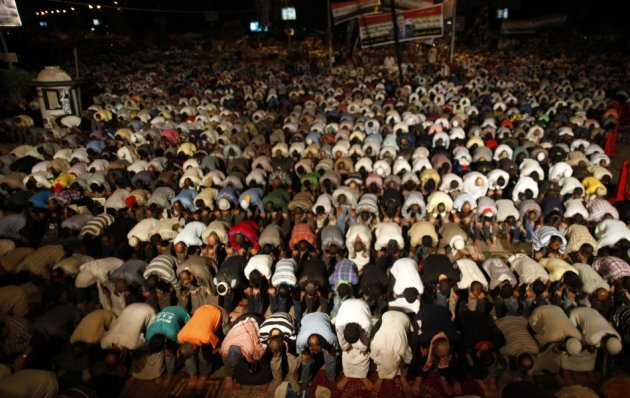 Supporters of deposed Egyptian President Mohamed Mursi perform dawn prayers at the Rabaa Adawiya square