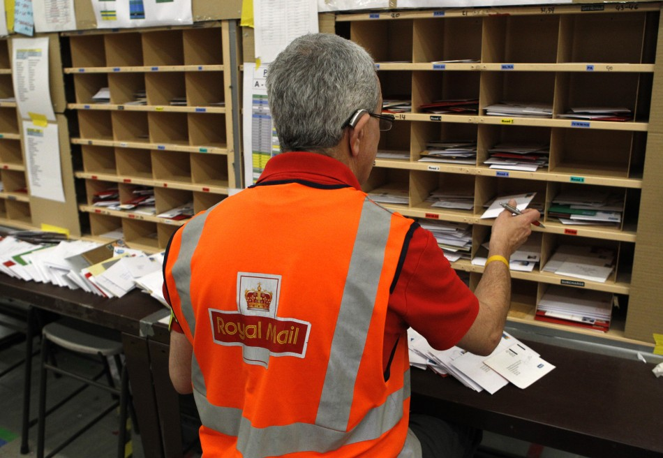 A Royal Mail worker sorts letters at the Edinburgh mail centre in Edinburgh
