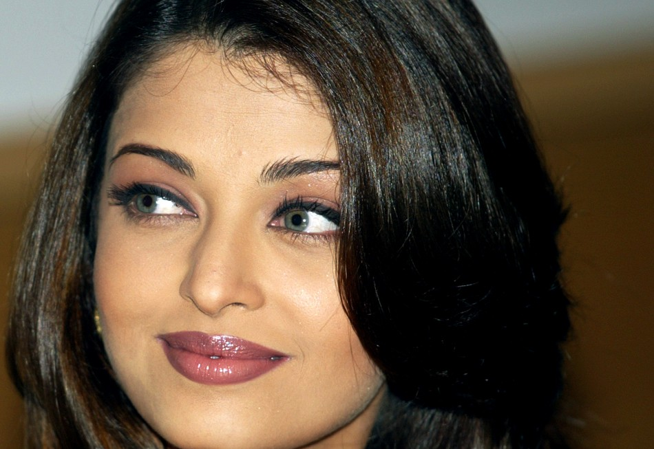 Bollywood star Aishwarya Rai smiles during the launch of a new television campaign for a cosmetic company in Bombay May 28, 2004