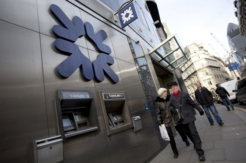 Pedestrians walk past a Royal Bank of Scotland building in central London