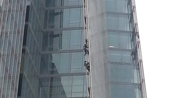Two of the protesters attempting to climb the Shard (Ewan Palmer/IBTimes)