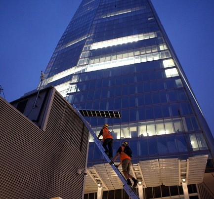 The climbers begin their ascent of The Shard in central London (Twitter/Greenpeace)