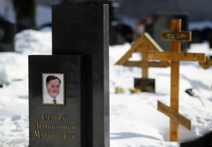 A picture of lawyer Sergei Magnitsky is seen on his grave in the Preobrazhensky cemetery in Moscow