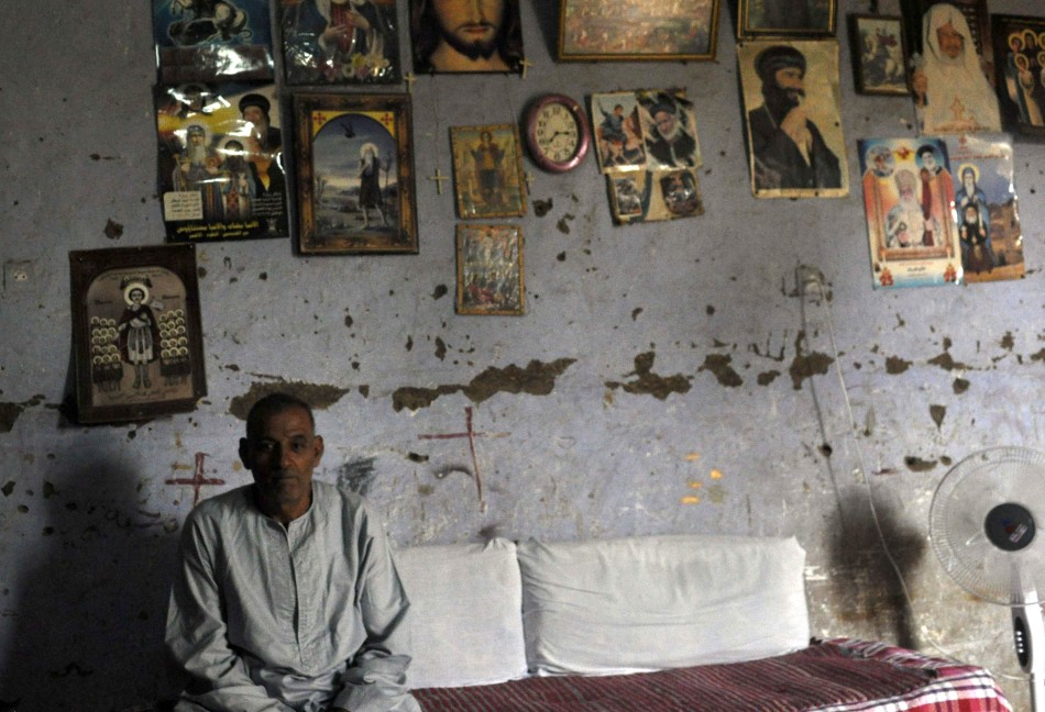 Abied Abdel-Nour, father of Dimiana, a Christian schoolteacher, is pictured in his home in Luxor,