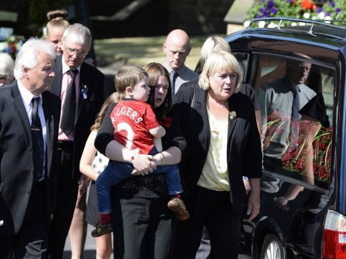 Rebecca Rigby (C), the wife of Fusilier Lee Rigby, and son Jack, arrive for a vigil at the Parish Church in Bury (Reuters)