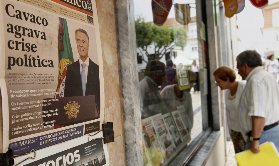 "The headlines of the newspaper on the wall reads, ""Cavaco deepens political crisis"". (Photo: REUTERS)"