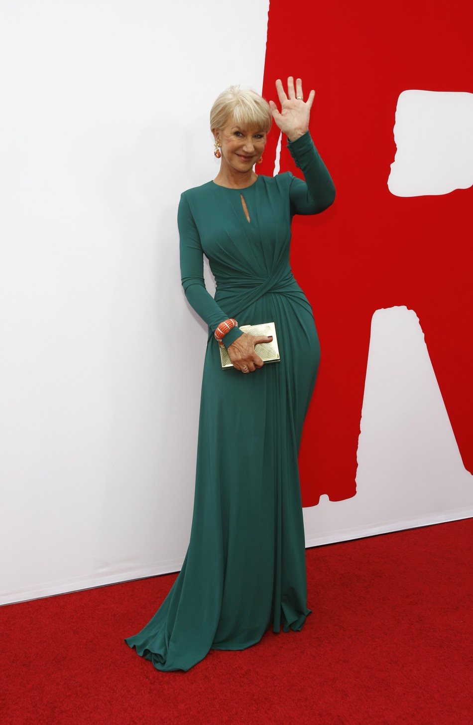 Helen Mirren waves at the premiere of the film Red 2 in Los Angeles, California July 11, 2013.