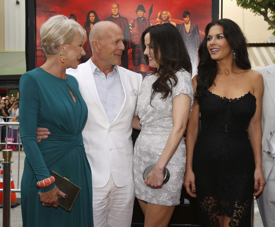 Cast member Bruce Willis poses with co-stars Helen Mirren L, Mary-Louise Parker 2nd R and Catherine Zeta-Jones at the premiere of the film Red 2 in Los Angeles, California July 11, 2013.