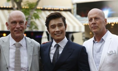 Cast members John Malkovich L, Lee Byung-hun of South Korea C and Bruce Willis pose at the premiere of the film Red 2 in Los Angeles, California July 11, 2013.