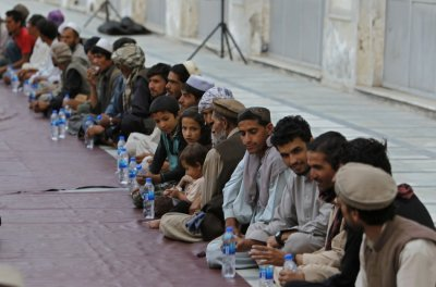 Afghan Muslims wait for their Iftar meal on the first day of Ramadan, the holiest month in the Islamic calendar, at a mosque in Kabul