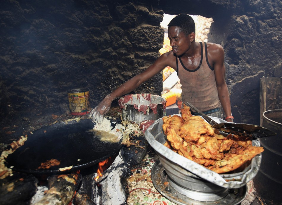 A Somali vendor prepares snacks to sell during the Muslim fasting month of Ramadan at Hmarwayne district, south of Mogadishu