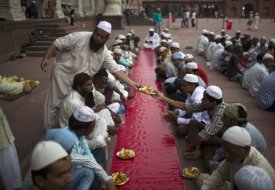 Muslims arrange plates before iftar breaking fast meal on the first day of the holy month of Ramadan in India