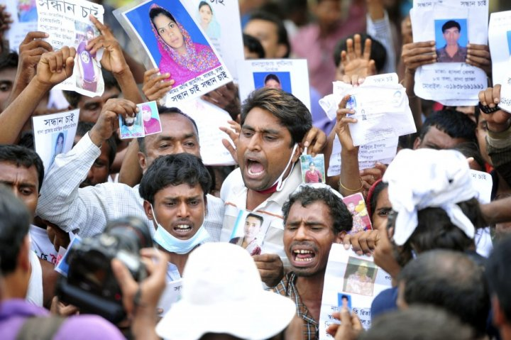 Relatives show pictures of garment workers, who are missing after the collapse of the Rana Plaza disaster (Photo: Reuters)