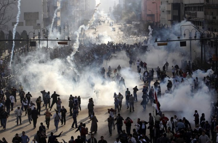 Protesters flee from tear gas fire during clashes in Cairo January 28, 2011 (Reuters)