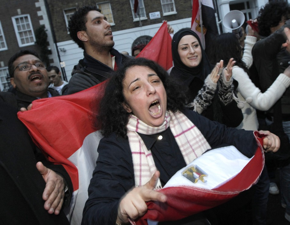 Egyptians and supporters celebrate the resignation of Egypt's President Hosni Mubarak outside the country's embassy in London (Reuters)
