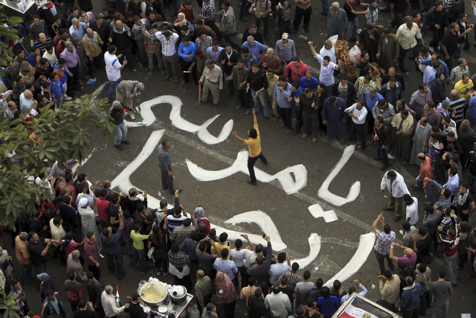 Protesters chant slogans against Egyptian President Mohamed Mursi during a demonstration at Tahrir square in Cairo (Reuters)